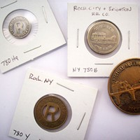 Local Memorabilia Governale's original subway & commemorative tokens. PHOTO BY KATHERINE STATHIS