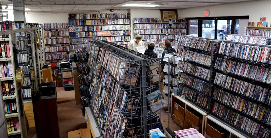 Hyatt Classic Video in East Rochester has shelves filled with DVDs and VHS tapes. - PHOTO BY MATT DETURCK