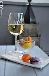 PHOTO BY MATT DETURCK - In addition to a deep wine list, Veritas Wine Bar serves light fare, including French macarons from Pittsford Dairy (pictured).