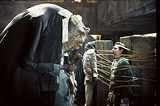TOUCHSTONE PICTURES - Intergalactic communication: A Vogon, Mos Def, and Martin Freeman in Hitchhikers Guide.