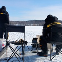 Ice Fishing Jeff and Tim Thomas watch their tip-ups for any activity on the Hundred Acre Pond at Mendon Ponds Park. PHOTO BY KATHY LALUK