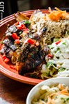 Jerk Chicken with rice and pigeon peas and a side salad.