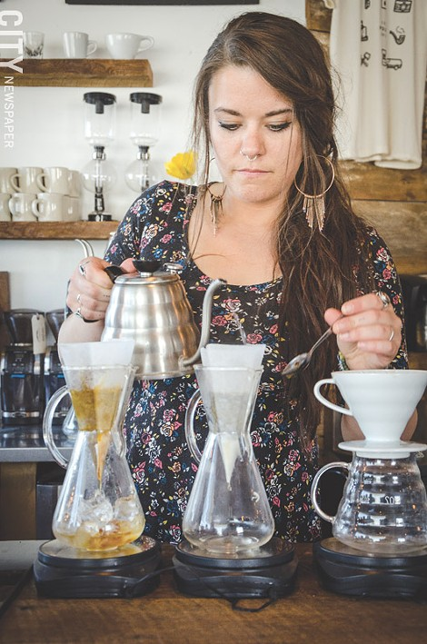 Joy Ebel brews coffee at Pour Coffee Parlor. - PHOTO BY MARK CHAMBERLIN