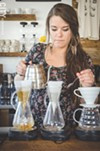 Joy Ebel brews coffee at Pour Coffee Parlor.
