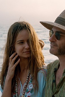 "Katherine Waterston and Joaquin Phoenix in ""Inherent Vice."""