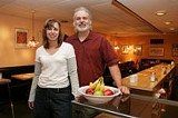 PHOTO BY GARY VENTURA - Keeping the bratwurst cooking: Flour City Diner owners Jerry and Kim Manley.