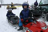 KURT BROWNELL - Kids take a break from the races at a Webster Ridge Runners snowmobiling event.