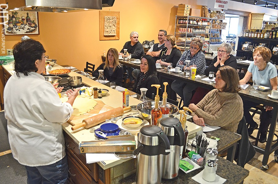 Learning to cook can benefit your palate and your wallet. Many area businesses offer cooking classes, including Rosario Pino's Artisan Foods in East Rochester (pictured). - FILE PHOTO