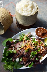 Marinated grilled pork with hot sauce and sticky rice. - PHOTO BY MATT DETURCK