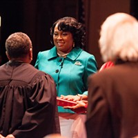 Mayor Lovely Warren's Inauguration Ceremony Mayor Warren takes the Oath of Office, administered from Judge Teresa Johnson, using her family Bible. PHOTO BY JOHN SCHLIA