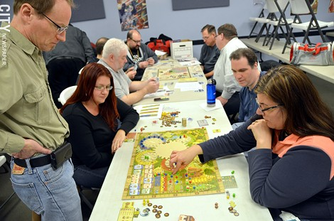 Members of the Rochester Boardgaming Society play a round of Tzolk'in: The Mayan Calendar. - PHOTO BY MATT DETURCK