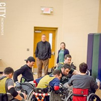 Quad Rugby Members of the WNY Wreckers — (left to right) Craig Mills, Dave Sprout, Chris Hilderbrant, Jerremy Lorch, Dave King, and Mike Bliss — scrimmage during a team practice. In the background: able-bodied volunteers Chris Wood and Erin Clegg. PHOTO BY MARK CHAMBERLIN