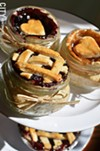 Miniature blueberry and apple pies in Bell jars.