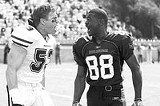 PARAMOUNT PICTURES - More than just team vs. team: Bill Romanowski and Michael Irvin in The Longest Yard.