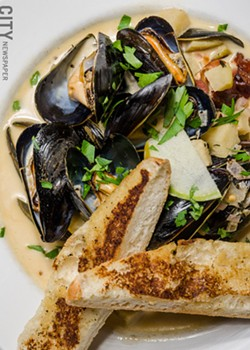 Mussels with green apple and apple cider cream sauce from Fraiche Bistro. - PHOTO BY MARK CHAMBERLIN