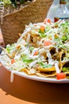 Nachos with chorizo, lettuce, tomato, onion, cheese, and sour cream from Wylie Chayote's Fine Mexican.