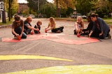 FILE PHOTO - Neighborhood of the Arts' 2013 street painting party.