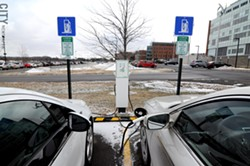 The parking lot outside of the sustainability institute's building has two electric vehicle charging stations. - PHOTO BY JEREMY MOULE