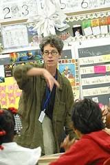 PHOTO BY KURT BROWNELL - One task at a time: School 29 teacher Dory Driss gives a stedent some individual attention.