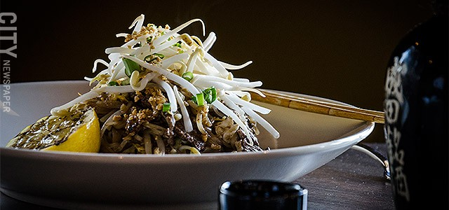 Pad Thai beef with traditional Thai noodles, peanuts, sprouts, eggs & scallions from Papaya.