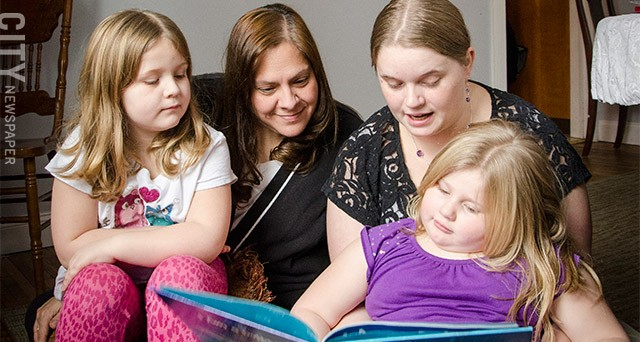 Parent Sarah Johns (right) with her daughters Emily and Lillian and Parents as Advocates instructor Susan Hall. Improving her daughters' reading skills is one of Johns' goals.