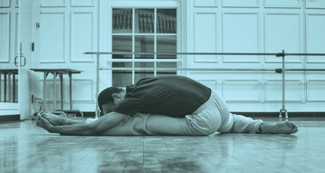 "(Pictured) Christopher Morrison, who leads the ""Move It"" program, stretches before a routine."