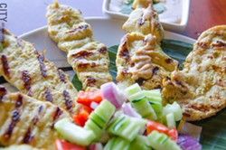 Pork satay skewers from Thai Time Cuisine. - PHOTO BY MARK CHAMBERLIN