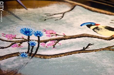 Progress on Katie Jo Suddaby's sand mandala from Saturday, September 20. - PHOTO BY MARK CHAMBERLIN
