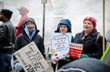 PHOTO BY MARK CHAMBERLIN - Protesters concerned about school funding protested outside while Governor Andrew Cuomo gave a budget presentation last week.