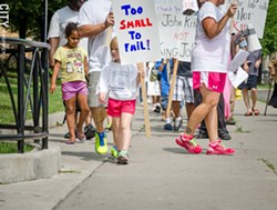 """About 60 people carrying signs with slogans like """"Keep Politics Away From Our Kids"""" and """"Life Is Not a Test"""" protested outside School of the Arts yesterday. - PHOTO BY MARK CHAMBERLIN"""