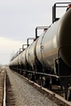 Railroad tanker cars similar to the ones shown here are used to transport domestically produced crude oil. The amount of crude moved by trains has increased dramatically in the past few years.