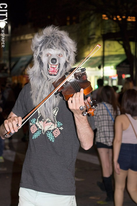 Random Wolf Man (wearing a wolf shirt) played violin on the streets of Austin during SXSW 2013. - WILLIE CLARK
