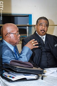 Rev. Willie Harvey and Bishop Jerry McCullough discuss Rochester schools and students. - PHOTO BY: MARK CHAMBERLIN