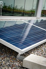RIT's Golisano Institute for Sustainability has a 400 kilowatt solar array on its roof. - PHOTO BY MARK CHAMBERLIN