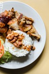 Roasted pork with white rice and beans.
