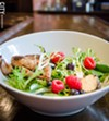 Roasted quail salad with raspberries and pepper-crusted goat cheese.