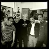 PROVIDED PHOTO - Rochester drummer Jason Smay (second from left) has played with the Hi-Risers and Los Straitjackets, and now beats the kit for up-and-coming national rhythm-and-blues star JD McPherson (second from right).