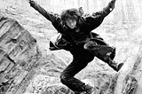 """WARNER BROS. - Running from a dragon: Daniel Radcliffe in """"Harry Potter."""""""