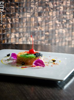 Salmon toro tartar (a patty of raw, diced salmon belly, blended with diced mango and topped with caviar and a maraschino cherry) - PHOTO BY MARK CHAMBERLIN