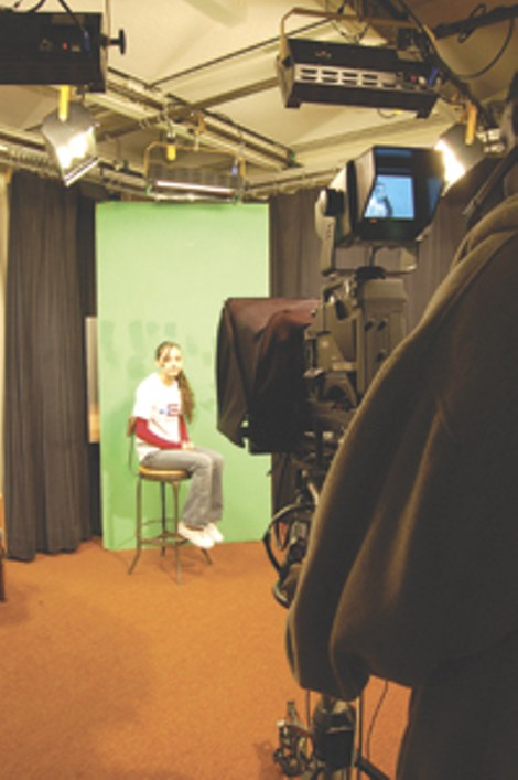 School Without Walls student Brandon Appleberry mans the - camera, with SOTA's Tiffany Torres as the anchor. - KARA DOUGHMAN