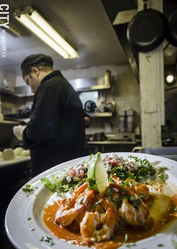 Shrimp al mojo de ajo & guajillo: Six large prawns marinated in garlic and guajillo sauce; served with fresh Mexican salad and rice. - PHOTO BY MARK CHAMBERLIN