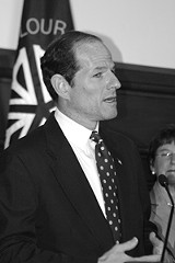 FILE PHOTO - Spitzer moves from campaign mode (above) to action.