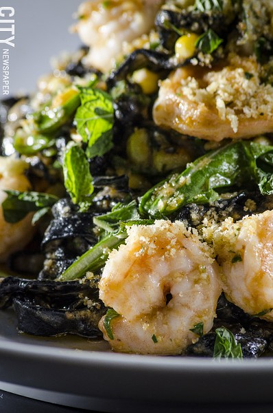 Squid ink fettuccine with rock shrimp, charred corn, arugula, tomato, and jalapeño from Avvino. - PHOTO BY MARK CHAMBERLIN