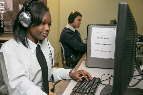 Students Amina Avjam and Abismael Diaz train on the 911 call center simulator. - PHOTO BY MIKE HANLON