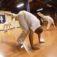 Capoeira at Com Expressao Students practice different sparring motions in a series of drills. PHOTO BY LARISSA COE