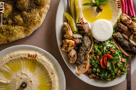 Sultan Lebanese Cuisine & Bakery specializes in traditional Lebanese dishes like (top left) Za'atar Manakeesh (flatbread with thyme, sumac, and olive oil) and Mashawi Combo (tabouli, hummus, chicken, beef, kafta kebab skewers, and pickled vegetables) - PHOTO BY MARK CHAMBERLIN