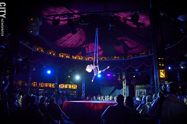 The Beautiful Heather performs an aerial feat as part of Cirque du Fringe, taking place in the Spiegeltent throughout the Rochester Fringe Festival.