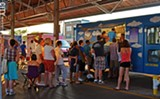 PHOTO BY MATT DETURCK - The line at Cheesed and Confused at the Public Market's previous Food Truck Rodeo in June.