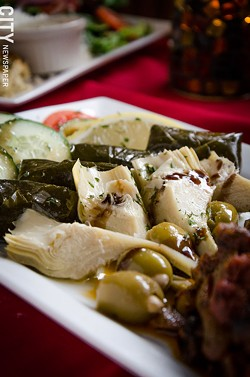 The Mediterranean antipasta appetizer with dolmades, artichoke hearts, olives, feta, and roasted red peppers. - PHOTO BY MARK CHAMBERLIN