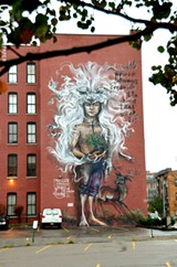"""PHOTO BY MATT DETURCK - The new mural at 218 Andrews Street, by German street-art duo Herakut, is part of the continuing """"Wall/Therapy"""" initiative. This piece is also part of a global mural series that may turn into a graphic novel written by actor Jim Carrey."""